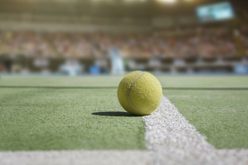 Tennis court background with audience and close up from a tennis ball