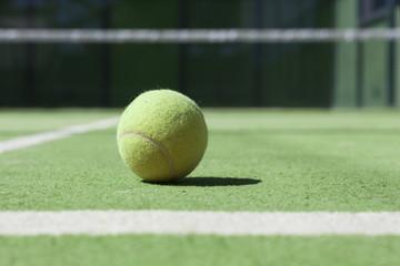 Tennis court with a close up ftom a tennisball