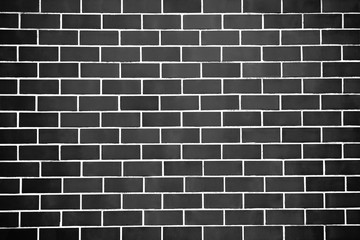 New perfectly black brick wall background. Best clean grey brick wall. Close up. Front view.