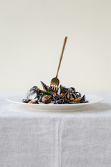 Plate of vongole with black pasta