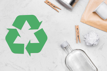 Eco concept. Waste recycling symbol with garbage on stone