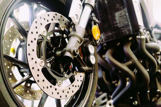 Close up of a motorcycle wheel, Suspension and disc brake system of modern motorcycle's front wheel.