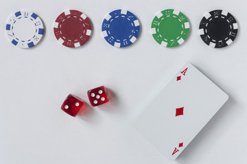 Gambling chips, dice and cards on white background