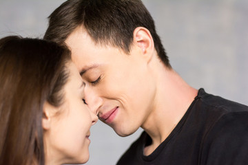 Portrait of young beautiful lovers. Studio shot of young couple of loving people with warm feeling of real love.