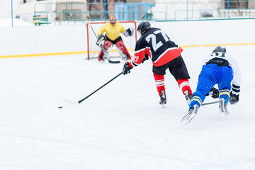Young skater man in attack. Ice hockey game image with copy space
