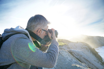 Photographer taking pictures of outdoor scenery