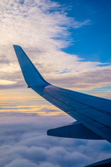 plane wing and sunset sky