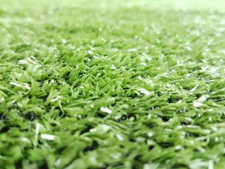 The green artificial grass decorated in the garden