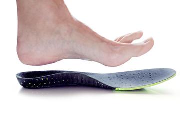 orthopedic insole and female leg