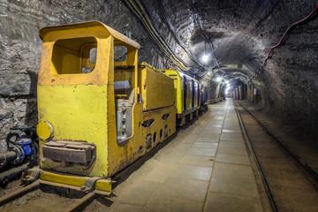Yellow passenger underground train in a mine