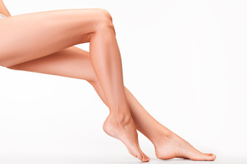 Woman legs on white background.