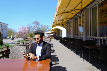 Arabian guy talking with friendby phone