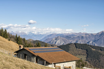 mountain lodge with solar panels