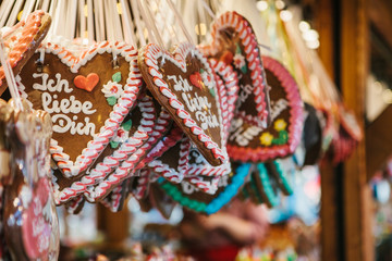 Traditional sweets in the Christmas market in Germany. Celebrating Christmas in Europe.