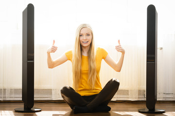 Woman next to speakers at home