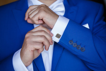 a man wearing a blue jacket and white shirt for the wedding