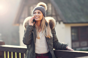 Happy woman enjoying winter season outdoors