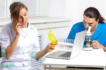 Doctor talking on a mobile phone in lab