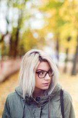 Beautiful young hipster woman with glasses