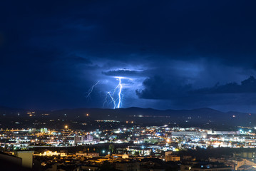 Lightning over the city at night