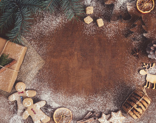 Gingerbread cookies and Christmas tree on wood board