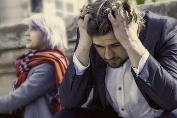Pain from the quarrel. Angry frustrated young people swearing. (Love, hate, unhappy, stress, negative emotion concept)