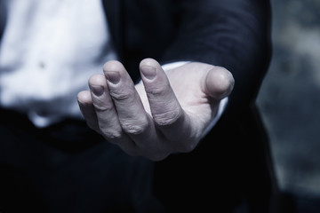 Close up hand of poor man begging you for help and asks for money as symbol of poverty, hunger, human rights.