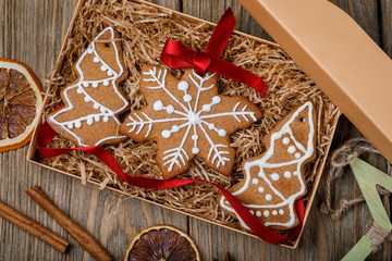 Christmas cookie in a box on a wooden table, top view. Home-made pastries of various shapes