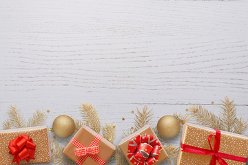 Christmas New Year background of Christmas decorations, fir branches, gifts, balls and blank space for a greeting text.