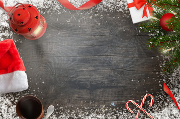Christmas New Year decorations on black wooden background. Top view with free blank space for text.