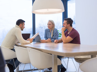 Startup Business Team At A Meeting at modern office building