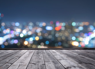 wood floor and blurred city light background