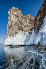 Cape on the lake Baikal transparent ice and crack