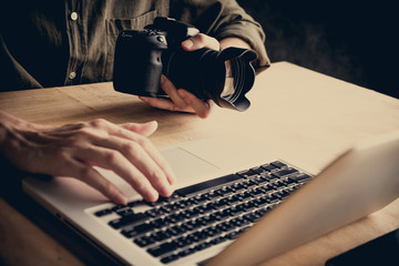Close up of photographer editing his images on laptop.