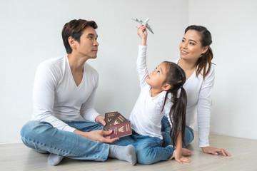 happy Family young mother father and daughter with toy plane and Thailand passports for trip