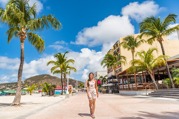 Wall Mural - St Maarten Woman tourist walking in shopping streets of Philipsburg, St Maarten, popular port of call for cruise ship travel destination. Caribbean tropical getaway.