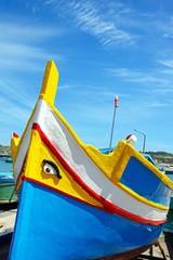 Front view of a traditional Maltese Dghajsa fishing boat, Marsaxlokk, Malta.