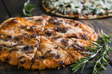Pizza with mushrooms and cheese on thin dough