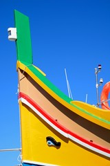 The front of a traditional Maltese Dghajsa fishing boat, Malta.