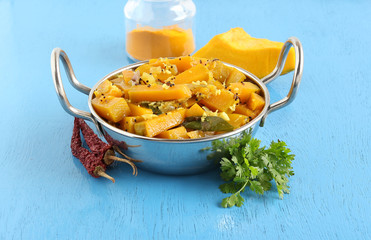 Sweet pumpkin curry, which is a healthy Indian vegetarian side dish for items like chapati, in a steel wok.