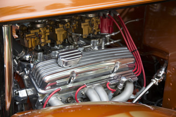 Under the Hood View of Restored Vintage Automobile Engine with Tri-Power Show-Chrome Carburetors