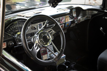 Isolated Interior View of Restored Tricked Out Vintage 50s Automobile Dashboard, Steering Wheel,  and Fabric Seats