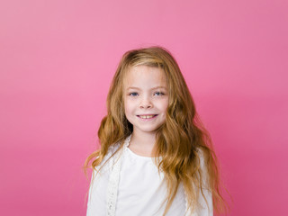 portrait of blond pretty girl in front of pink background with different emotions in the studio