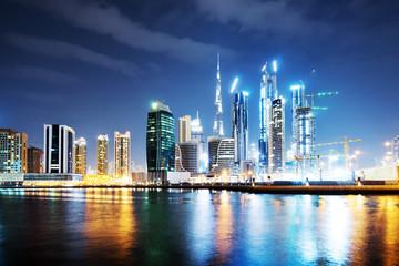 modern buildings near water at night