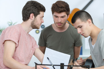Three young musicians conferring
