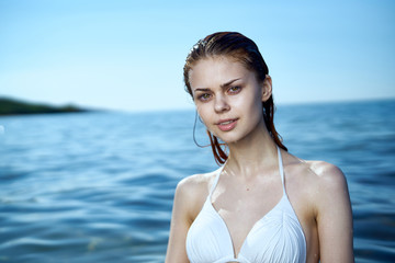Beautiful young woman is resting on the sea, beach, summer, sun, vacation