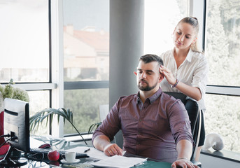 Businesswoman massaging shoulders to colleague at office. Office massage.