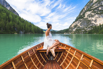 Lake Braies,Braies,Bolzano province,Trentino Alto Adige,Italy.Girl admires the Braies Lake by boat.
