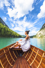 Lake Braies, Braies, Bolzano province, Trentino Alto Adige, Italy. .Girl admires the Braies Lake by boat.