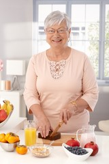 Mature woman preparing healthy breakfast